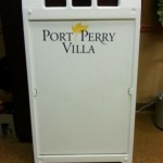 This durable plastic sandwich board can be weighted down with water or sand for a windy area outside