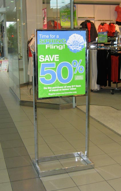 This frame holds posters or signs easily for indoor spaces like a shopping mall. Easily interchangeable messages