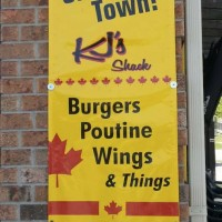 Canadian Banner is designed to attract attention and go with theme of black and red