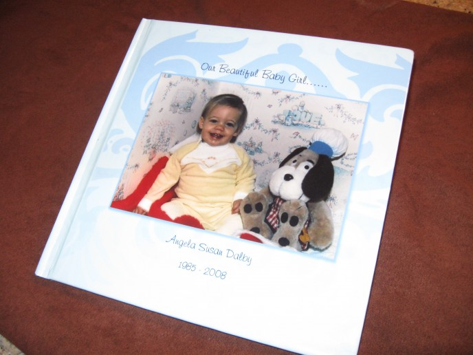 Personalized photobook custom made to your colours, images, text, font, pages, style and reference.