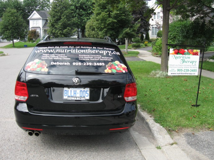 This little car looks stunning with white vinyl lettering and digital images... her stake sign was done to match vehicle and is great advertising for a home based business!