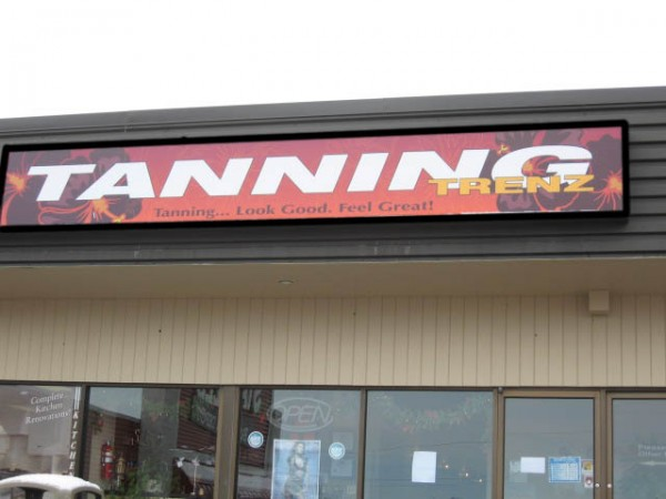 This backlit plexiglass sign was designed and printed on clear vinyl which was then applied to translucent white plexiglass.... very pretty at night when all the oranges and pinks glow.