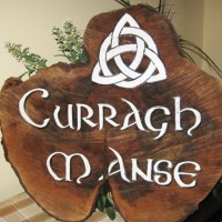 This was a very custom cottage sign given as a gift... hand painted and varathaned, this client was very happy with the detail and celtic cross. Graphic design by Sue.