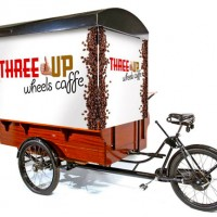 One-of-a-kind coffee cart gets a vibrant look with banners to identify.